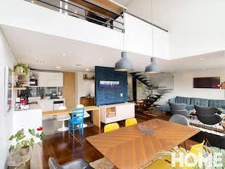 Una sala de estar llena de muebles y una televisión de pantalla plana en PENTHOUSE DUPLEX en Chico-Doble altura- 2 alcobas