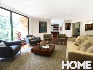 Una sala de estar llena de muebles y una televisión de pantalla plana en Apartamento en Bella Suiza, Bogota - tres habitaciones