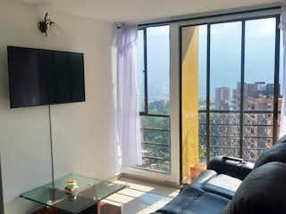 Una sala de estar llena de muebles y una ventana en APARTAMENTO EN RODEO ALTO