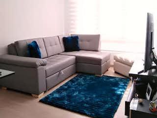 Una sala de estar llena de muebles y una ventana en Apartamento en venta en Gilmar de tres habitaciones