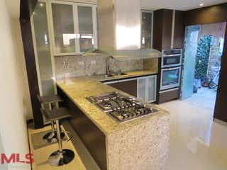 Una cocina con una estufa y un refrigerador en No aplica