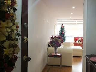 Una sala de estar con un árbol de navidad en ella en Apartamento en venta en Mazurén de 91m²