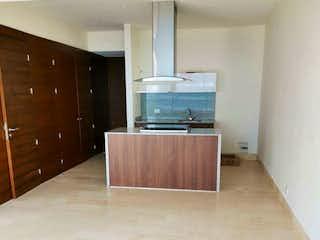 Un televisor de pantalla plana sentado en la parte superior de un soporte de madera en Departamento en venta en Granada, de 63mtrs2