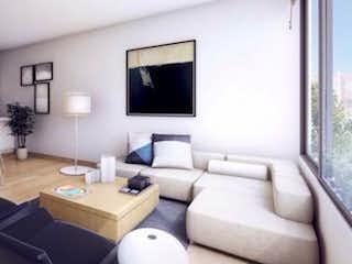 Una sala de estar llena de muebles y una televisión de pantalla plana en Apartamento en venta en San Patricio de una habitacion