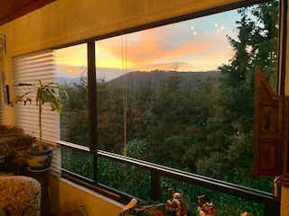 Una vista de una vista desde la ventana de una casa en VENTA  CASA EN CONDOMINIO CUAJIMALPA