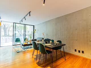 Una habitación llena de muebles y suelos de madera en Rio Lerma 60