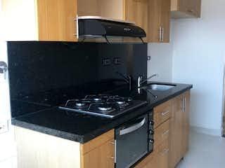 Una estufa encima del horno sentado dentro de la cocina en Se Vende Apartamento Duplex en San Joaquín ,Medellin