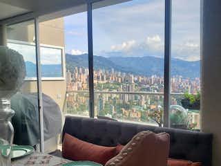 Una sala de estar llena de muebles y una gran ventana en Apartamento En Venta En Medellin Las Palmas