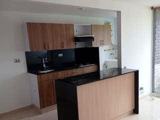 Una cocina con un horno encimera negro en Apartamento en venta en Loreto, de 58mtrs2