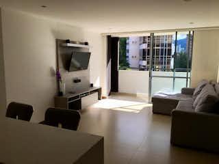 Una sala de estar llena de muebles y una televisión de pantalla plana en Apartamento en venta en Los Balsos, de 63mtrs2
