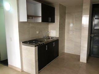 Una cocina con una estufa y un fregadero en Apartamento en venta en Madelena de 2 habitaciones