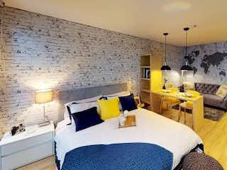 Una sala de estar llena de muebles y una televisión de pantalla plana en Apartamento en venta en Barrio Teusaquillo de 36m² con Bbq...