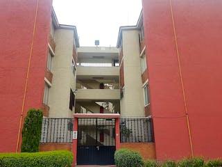 Un edificio de ladrillo rojo con una ventana grande en DEPARTAMENTO AL LADO DE PREPA 5 1ER. PISO
