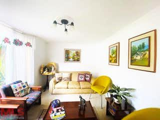 Una sala de estar llena de muebles y una pintura en Quintas De Zuñiga