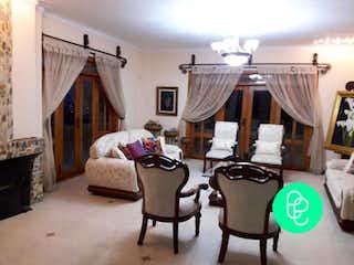 Una sala de estar llena de muebles y una ventana en PARCELACION MIRADOR DE SAN JUDAS