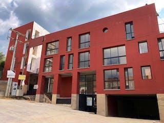 Un edificio de ladrillo rojo con un edificio de ladrillo rojo en VENDO APARTAESTUDIO  LA CANDELARIA-MONTFORT SUITES