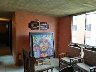 Un televisor de pantalla plana sentado en la parte superior de un soporte de madera en Ganga Gran Oportunidad Se Vende Apartamento En Zipaquir Zona San Rafa