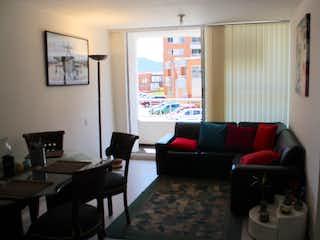 Una sala de estar llena de muebles y una ventana en Alameda , san rafael, zipaquira