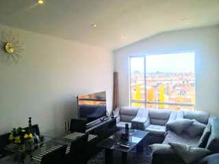 Una sala de estar llena de muebles y una televisión de pantalla plana en SE VENDE LINDO APARTAMENTO ZIPAQUIR