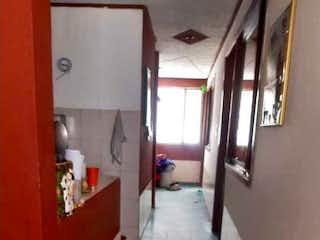 La vista del pasillo desde la puerta en VENTA/PERMUTA CASA BARRIO AMPARO KENNEDY