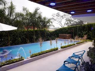 Una vista de una palmera y un parque en Casa en venta en Casco Urbano San Jerónimo con acceso a Jardín