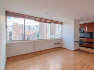 Una habitación muy bonita con una gran ventana en Apartamento en Venta POBLADO