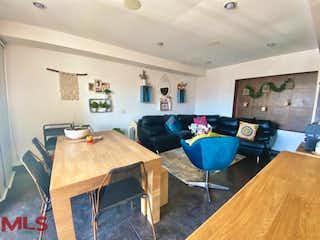 Una sala de estar llena de muebles y una mesa de madera en Santa Ana (Santa Teresita)