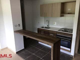 Una cocina con un fregadero y una estufa en Quinta Estrella