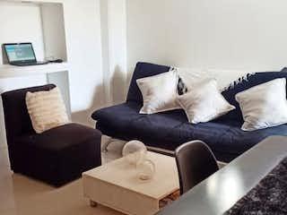 Una imagen de una sala de estar con un sofá en Apartamento en venta en San Joaquín de 1 alcoba