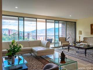 Una sala de estar llena de muebles y una gran ventana en APARTAMENTO EN VENTA SECTOR EL CES