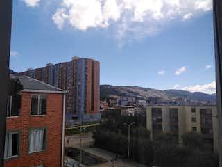 Un gran edificio de ladrillo con una torre de reloj en Apartamento en Venta TIBABITA
