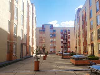 Una calle de la ciudad llena de muchos edificios altos en Apartamento en Venta en Villa Magdala - Usaquén