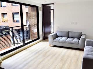 Una sala de estar llena de muebles y una ventana en Apartamento en venta en Bella Suiza, 92mt con balcon