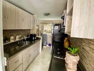 Una cocina con nevera y fregadero en Apartamento en venta en Calasanz de tres habitaciones