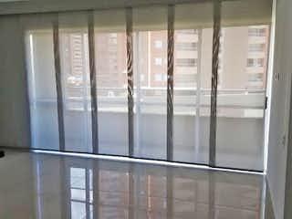 Una puerta de cristal se muestra con una puerta de cristal en Apartamento en venta en San Germán de tres habitaciones