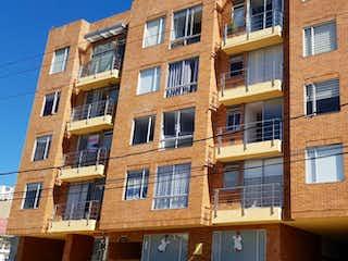 Un gran edificio de ladrillo con un edificio de ladrillo rojo en Apartamento En Venta En Bogota Spring