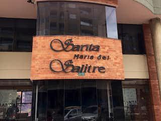 Un edificio de ladrillo con una señal en él en Apartamento en Venta EL SALITRE