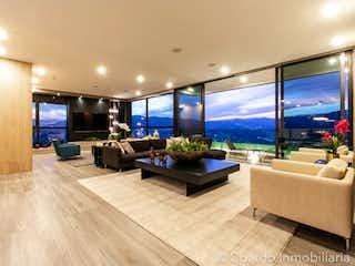 Una sala de estar llena de muebles y una gran ventana en APARTAMENTO EN VENTA SECTOR LOS BALSOS