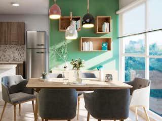 Una cocina con una mesa de comedor y sillas en Fenix