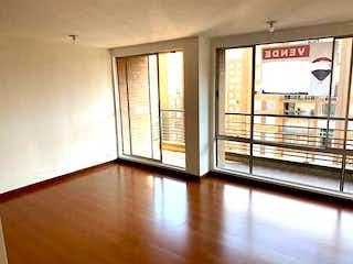 Una vista de una habitación con una puerta corredera de cristal en Apartamento En Venta En Bogota La Felicidad