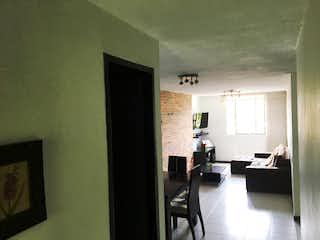 Una sala de estar llena de muebles y una ventana en Apartamento en Venta PRADO