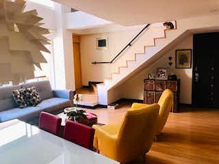 Una sala de estar llena de muebles y una televisión de pantalla plana en 103310 - Elegante y cómodo  Apartamento dúplex en Bella Suiza