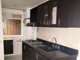 Una cocina con una estufa negra encima del horno en Apartamento en venta en La Candelaria 50m² con Balcón...
