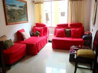 Una sala de estar llena de muebles y una ventana en Apartamento En Venta En Bogota Ciudad Tintal