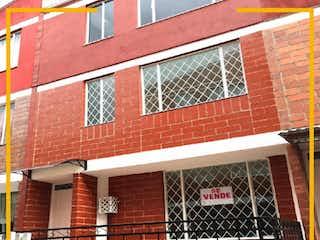Un edificio de ladrillo rojo con un edificio de ladrillo rojo en CASA EN VENTA EN ALAMOS NORTE