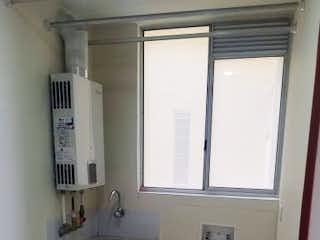 Un cuarto de baño con lavabo y un espejo en Apartamento en Venta GRAN GRANADA