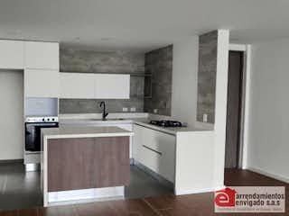 Una cocina con una estufa y un refrigerador en NOGALES