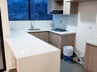 Un cuarto de baño con lavabo de bañera y espejo en Apartamento en venta en Los ángeles con acceso a Gimnasio