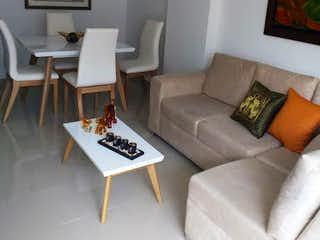 Una sala de estar llena de muebles y una televisión de pantalla plana en Apartamento en Venta SAN JOAQUIN