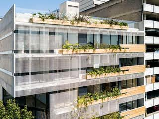 Un gran edificio con un reloj en la parte superior en Penthouse  en venta en Cyta Condesa